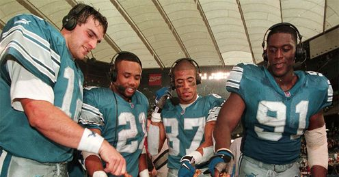 The 1999 Detriot Lions enjoy some Thanksgiving tradition after beating the Bears