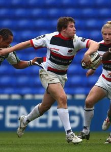 Adam Powell of Sarries has a break against Exiles