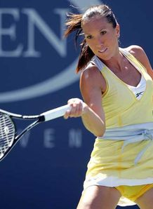 Jankovic battles into last eight