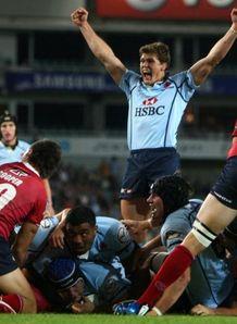 Luke Burgess celebrates