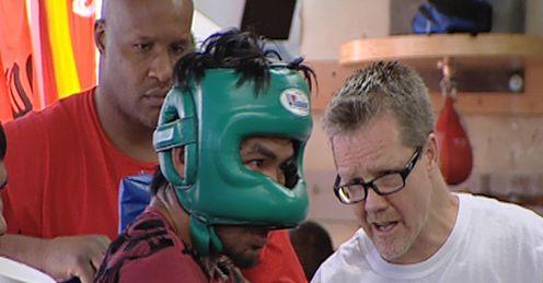 Pacquiao: takes some tips of Roach as Moorer watches on