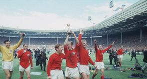 Jubilant England players parade the trophy around Wembley