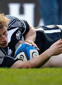 Ben Cairns sliding over for Scotland