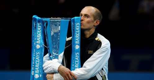 Loving it: Davydenko celebrates after finishing the season in style
