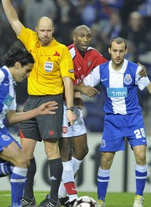 The ref blocks Sol Campbell against Porto