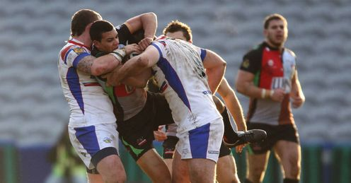 Triple-teamed: Harlequins' Ben Jones-Bishop feels the full weight of Wakefield