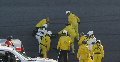 Running repairs: workers frantically fill a hole in the ageing Daytona tarmac