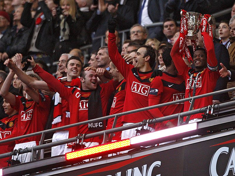 Patrice-Evra-Carling-Cup-final-trophy-PA_2425601.jpg