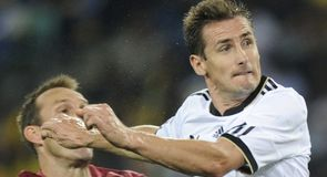 Miroslav Klose heads in Germany's second...