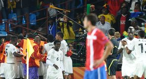 Ghana celebrate with goalscorer Asamoah Gyan.