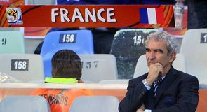 France coach Raymond Domenech alone to face the music before the kick-off.
