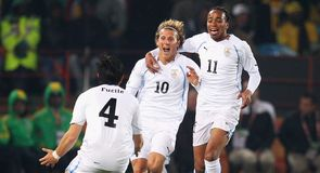 Diego Forlan celebrates his opener with Jorge Fucile and Alvaro Pereira