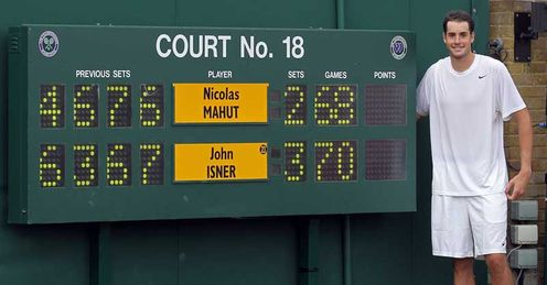 Up in lights: Isner celebrates but a fifth-set tie-break would have made his epic win impossible