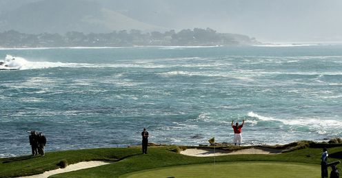 The world famous 17th green at Pebble Beach with Monterey Bay in the background