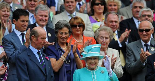 Wave of applause: distinguished guests greet the Queen on her long-awaited return to SW19