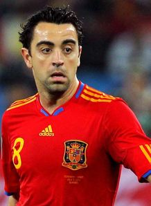 Xavi proud to reach century
