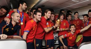 Spain celebrate on the plane as they arrive in Madrid to celebrate their World Cup success...