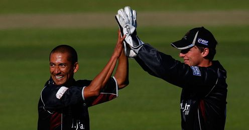 Plan comes together: Thomas (left) celebrates another well-executed wicket for Somerset