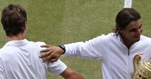 Back-hand winner: Nadal (right) commiserates with Berdych after Sunday's Wimbledon final