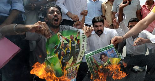 Heated issue: fans torch posters of Pakistan players during a protest in Rawalpindi