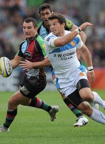 George Lowe of Quins cuts inside Mark Foster