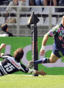 Stade Francais s winger Ollie Phillips v brive