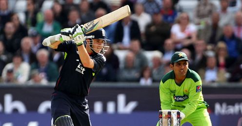 Fast hands: opener Davies drives through the off-side as Kamran Akmal looks on