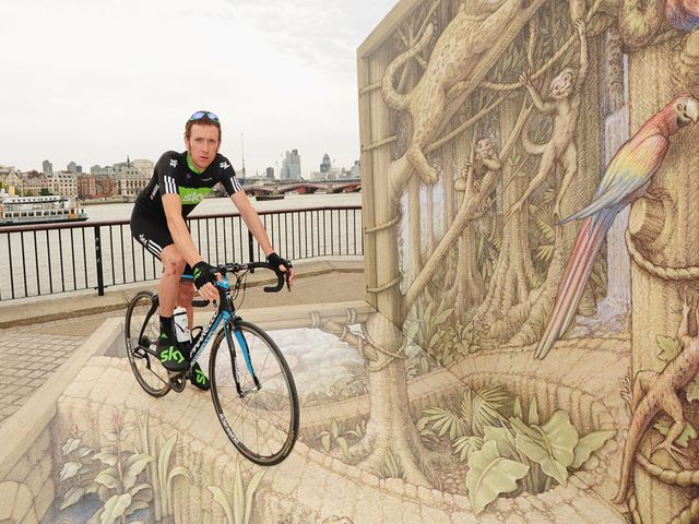 Wiggins: Proudly sports the rainforest rescue kit in front of a 3D image created by acclaimed artist Kurt Wenner