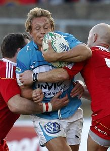 Jonny Wilkinson held by Munster