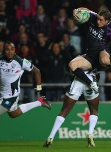 Shane Williams leaping against London Irish