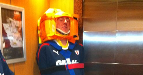 Lifting spirits: John Ledger is strapped to a stretcher and stuck in an elevator!