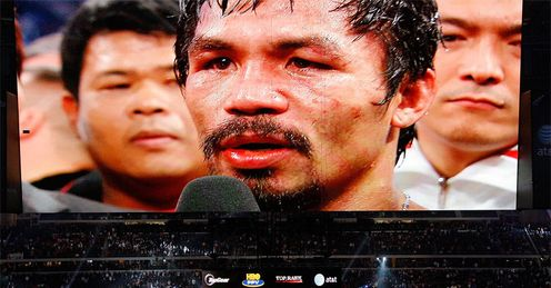 Huge star: Pacquaio on the big screen at the Cowboys Stadium