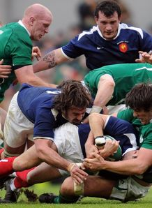 France nine Morgan Parra brought down against Ireland