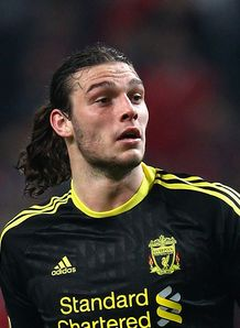 Dalglish defends Carroll