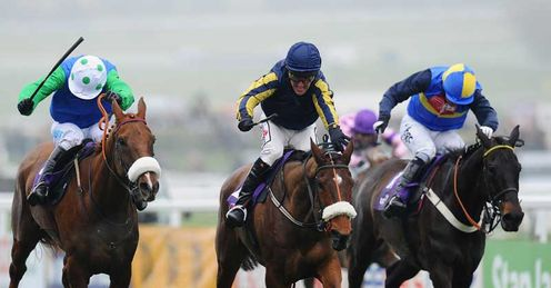 Robbie Power (centre) celebrates winning The RSA Chase on Bostons Angel at Cheltenham last March