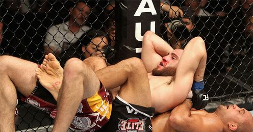Floored: BJ Penn (bottom) couldn't quite get to grips with Fitch
