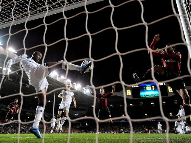 tottenham hostpur's william gallas clears a.c. milan goal off of the line.