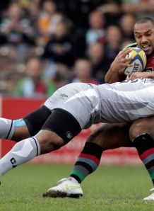 Harlequins centre Jordan Turner Hall hit hard against Leicester