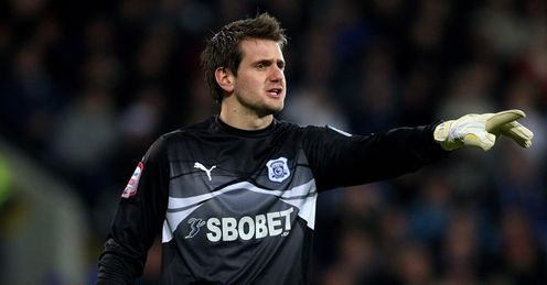 Tom Heaton: Hoping to help Cardiff prolong their Carling Cup adventure and push for promotion