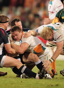 Coenie Oosthuizen of Cheetahs is tagged by Greg Somerville