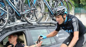 Michael Barry gets supplies from Sean Yates during the stage