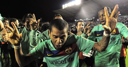 Alves: celebrates winning La Liga, but what about the Champions League?