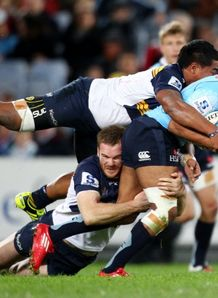 Kurtley Beale tackled in Waratahs against Brumbies