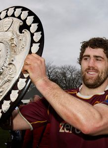 Jamie Mackintosh holding Ranfurly Shield aloft