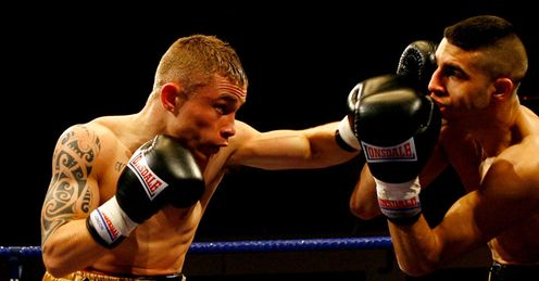 First to the punch: Frampton (left) during a victory over Yohan Boyeaux in 2010
