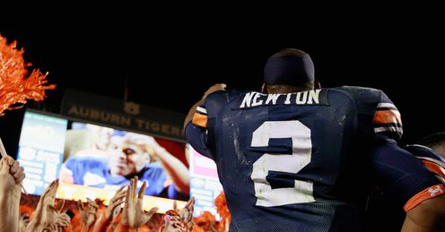 Newton: celebrates Auburn's success with crazy fans