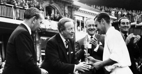 Licence to thrill: Bond receives the 1971 Gillette Cup from MCC President Sir Cyril Hawker