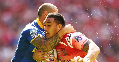 High stakes: Wigan's Jeff Lima absorbs a tackle in the Challenge Cup Final at Wembley