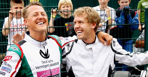 Bright outlook: Vettel enjoys a lighter moment with Michael Schmacher at a go-karting event