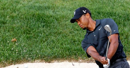 Sand and deliver: Woods escapes a bunker during a practice round at Akron